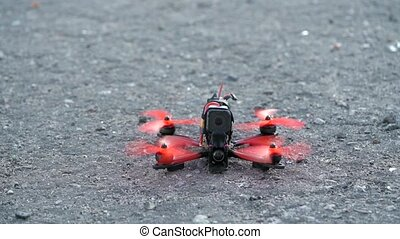 Slow motion of FPV freestyle drone getting ready to take off...