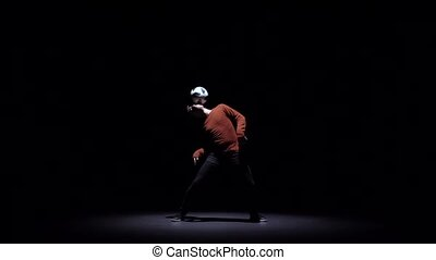 Slow motion of guy fellow making tricks with ball on head -...