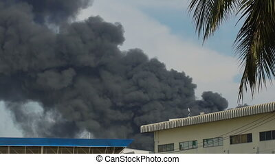 Slow motion of huge fire blaze from burning oil factory in...