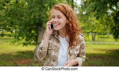 Slow motion of joyful teenager laughing talking on mobile ...