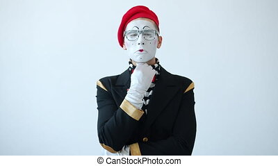Slow motion of mime artist scratching head thinking touching chin with contemplative face standing alone on white background. Ideas and pantomime concept.