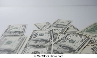 Slow motion of money falling on table. Money Piles.