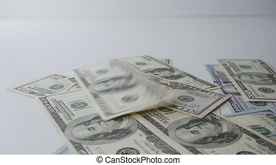 Slow motion of money falling on table. Money Piles. - Slow...