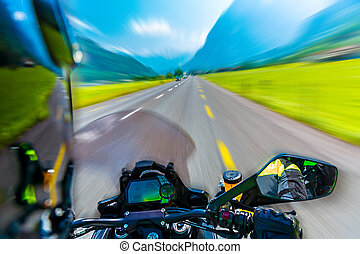 Slow motion of motorbike riding on the mountainous highway,...