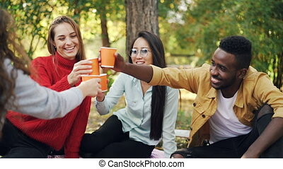 Slow motion of multiracial group of students talking and...