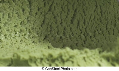 Slow motion of pistachio ice cream being scooped close up, ...