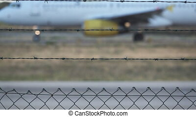 Slow motion of plane behind grille - Slow motion of blurred...