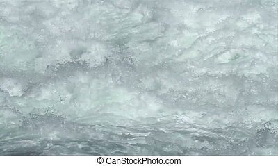 Slow motion of rough water