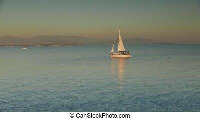 Slow motion of sailing yacht on the horizon. 4k