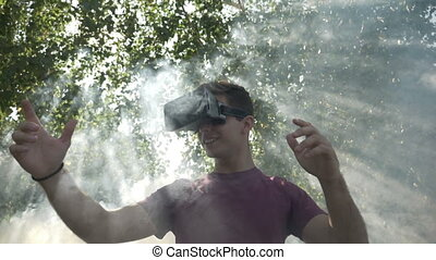 Slow motion of surprised young man with VR goggles feeling...