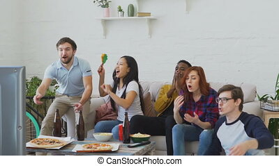 Slow motion of young friends watching olympic games match on...