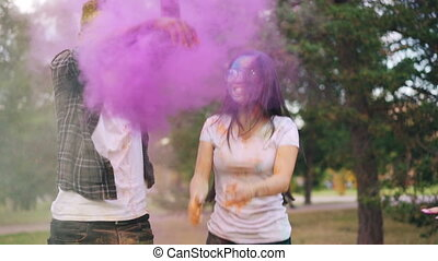Slow motion of young people couple jumping at Holi festival...