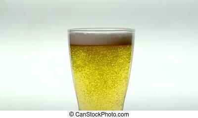 Slow Motion Pale Ale Beer Glass - Bubbles rise under foam on...