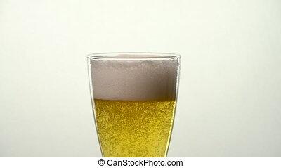 Slow Motion Pale Ale Beer Glass - Bubbles rise under foam.