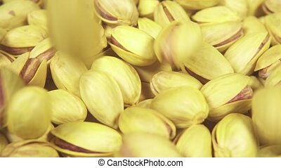 Slow motion pistachios fall on pistachios - Slow motion raw...