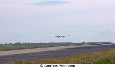 Slow motion. Plane landing.
