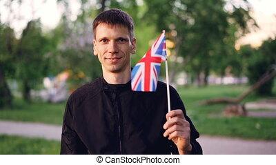 Slow motion portrain of happy englishman proud citizen...