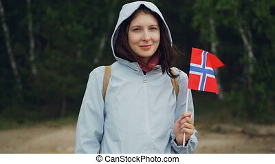 Slow motion portrait of attractive Norwegian sports fan...
