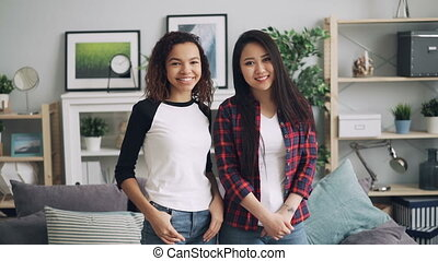 Slow motion portrait of beautiful young ladies Asian and ...