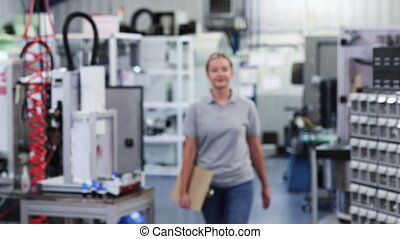 Slow Motion Portrait Of Female Engineer In Factory Walking...