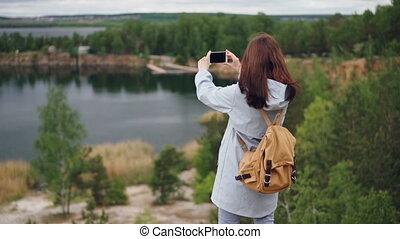 Slow motion portrait of girl traveller with knapsack taking...