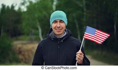Slow motion portrait of handsome guy American citizen...