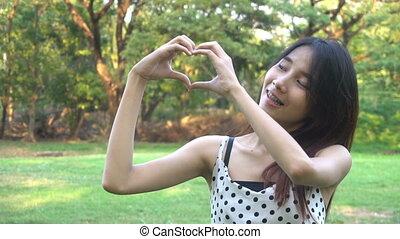 Slow motion portrait of joyful Asian woman. - Slow motion ...