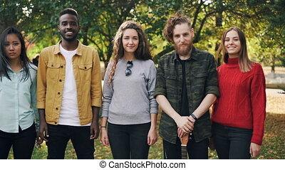 Slow motion portrait of multi-ethnic group of friends happy...