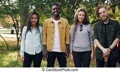Slow motion portrait of multiracial group of students girls...