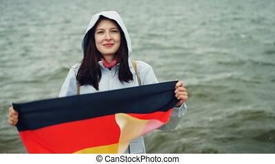 Slow motion portrait of pretty German woman proud citizen...