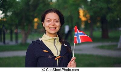 Slow motion portrait of pretty Norwegian woman waving...