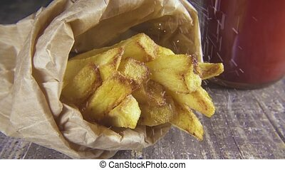 Slow motion potatoes in a package sprinkle with salt - Slow...