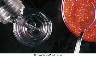 Slow motion pour the vodka in a glass on the table with...
