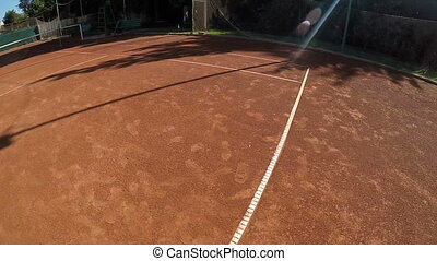 Slow motion POV woman serving and playing tennis match