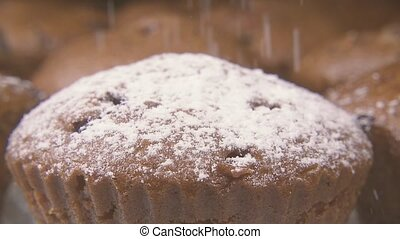 Slow motion powdered sugar pour on muffins close up - Slow...