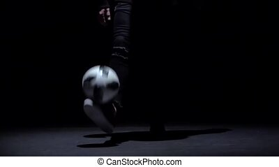 Slow motion, professional soccer player's legs making tricks...