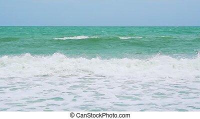 slow motion, sea waves on a tropical beach