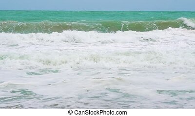 slow motion, sea waves on the coast of a tropical island