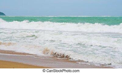 slow motion, sea waves on the coast of a tropical island, paradise