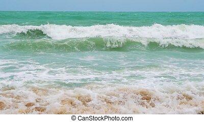 slow motion, sea waves on the coast of a tropical island, sandy beach