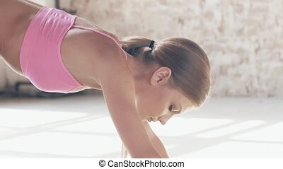 Slow-motion shooting exercises Yoga close-up. Sporty girl doing exercises on mate. Magnificent stretching and stability of the t