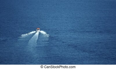 Slow motion shot of a motorboat speeding on the sea - Slow...