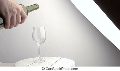 Slow motion shot of Pouring red wine into glass.