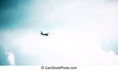Slow motion shot of propeller aircraft flying high in the sky