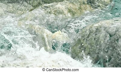Slow motion shot of sea wave splashes on rocks - Slow motion...