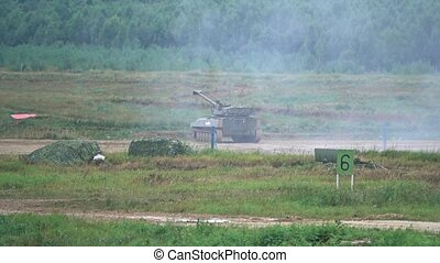 Slow motion shot of shooting Russian army self-propelled artillery