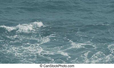 Slow motion shot of splashing sea waves