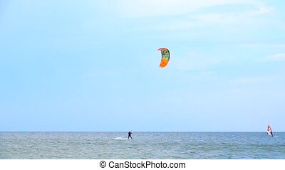 slow motion slow motion Young man practicing kitesurfing on...