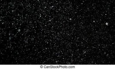 Slow Motion Snow on Black Background,