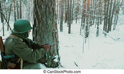 Slow Motion Soldier dressed as USA Infantry Soldier Of World War II Aiming And Shooting From Pistol Gun Weapon. American Soldier In Attack In Winter Forest